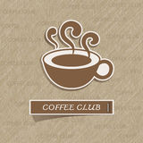 Coffee cup sticker on brown paper Royalty Free Stock Image