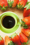 Coffee cup in strawberries frame Royalty Free Stock Images
