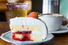 Coffee cup and strawberry cake in coffee shop ,coffee relax time Stock Photography