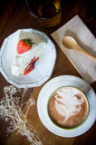 Coffee cup and strawberry cake in coffee shop  with wood backgro Royalty Free Stock Photos