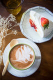 Coffee cup and strawberry cake in coffee shop  with wood backgro Stock Image
