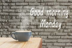 Coffee cup with stream of vapour against white brick wall background. Hot Coffee cup with stream of vapour against white brick wall background. Morning monday stock image