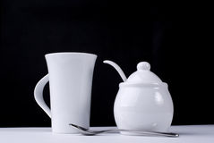 Coffee cup and sugar. White coffee cup and sugar bowl Stock Image