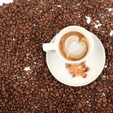Coffee cup with sugar and beans on a white background. Stock Image