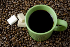 Coffee cup with sugar cube and coffee beans Stock Photography