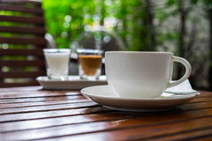 Coffee in cup and sugar on morning time low view. Coffee in cup and sugar on morning time put on wood table low view Stock Image