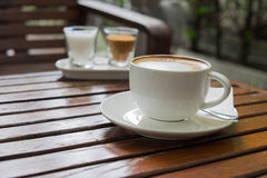 Coffee in cup and sugar on morning time. Put on wood table Royalty Free Stock Images