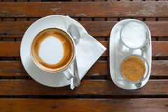 Coffee in cup and sugar on morning time. Put on wood table stock photography