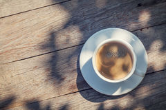 Coffee cup on sunny garden table Royalty Free Stock Images