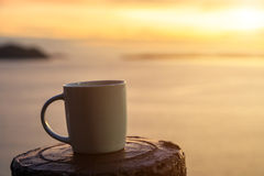 Coffee cup and sunset Stock Image