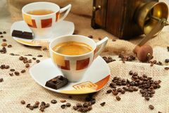 Coffee cup surrounded by coffee grains Stock Photography
