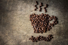 Coffee cup symbol made from coffee beans. Royalty Free Stock Photo