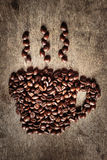 Coffee cup symbol made from coffee beans. Stock Images