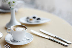 Coffee cup on a table Stock Image