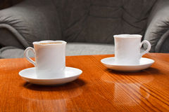 Coffee cup on table. 