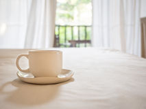 Coffee cup on Table with Blurred Home interior royalty free stock photo
