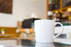 Coffee cup on table Stock Photos