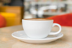 Coffee cup on table in cafe . Royalty Free Stock Photo