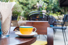 Coffee cup on table in cafe Stock Image