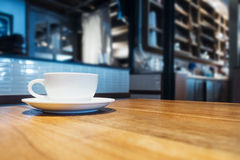 Coffee cup on table in cafe shop interior Royalty Free Stock Photo