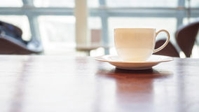 Coffee cup on table in cafe shop interior. Restaurant concept Stock Image