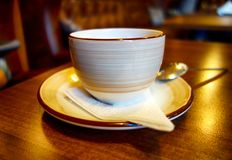 Coffee cup on the table in caffe. Close-up royalty free stock image