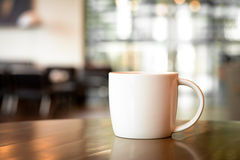 Coffee cup on the table in coffee shop Stock Images