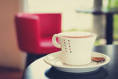 Coffee cup on the table in coffee shop - vintage style color effect Royalty Free Stock Photos