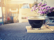 Coffee cup on table with flower decoration Vintage Tone royalty free stock photography