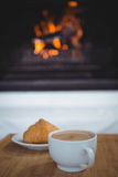 Coffee cup on table next to sweet food Stock Photos