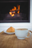 Coffee cup on table next to sweet food Stock Photography