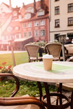 Coffee cup on table of outdoor cafe Royalty Free Stock Photo
