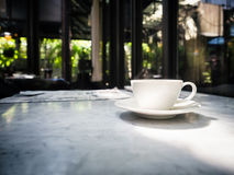 Coffee cup on table Restaurant cafe interior Stock Images
