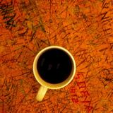 Coffee cup on table. Coffee cup on rustic carved table Stock Photography