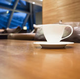 Coffee cup on table with shop cafe interior background Royalty Free Stock Photography
