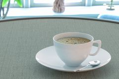 Coffee in a cup on the table by the window stock illustration