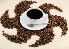 Coffee. Cup of coffee on the tablecloth Stock Photos