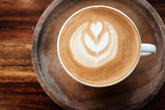 Coffee cup on tabletop. Beautiful coffee cup on wood tabletop Royalty Free Stock Image