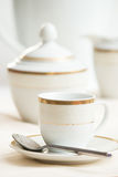 Coffee cup and tableware. Coffee cup with golden details and tableware Stock Images