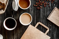 Coffee cup take away at wooden background top view Royalty Free Stock Photography