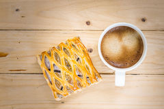 Coffee cup with taro pie taken in top view Stock Image