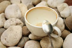 Coffee cup with tea spoon on stone background. Stock Images
