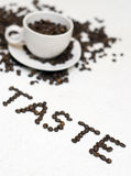 Coffee cup text - 'taste' Stock Photo