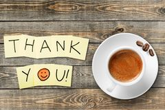 Coffee cup and thank you note   on wooden. Cup coffee note thank you background shape closeup Royalty Free Stock Photos