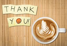 Coffee cup and thank you note   on wooden. Cup coffee note thank you background shape closeup Stock Photos