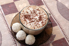 Coffee cup with three coconut cakes Stock Images