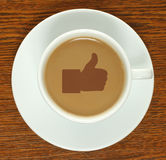 Coffee cup with thumb up Royalty Free Stock Photography