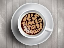 Coffee cup with time lettering about It Is Time to start again on realistic wooden background. Cappuccino from above Stock Photo