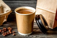 Coffee cup to go at wooden background Stock Photo