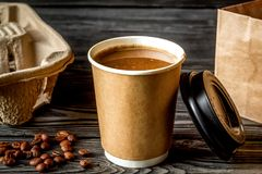 Coffee cup to go at wooden background Stock Photos